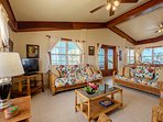 High ceilinged expansive and tasteful living room!