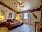 Another view of master bedroom with local artwork highlighted
