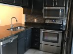 Brand new appliances with granite countertops