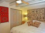 Master bedroom large closet, viga ceiling, ceiling fan, king bed and fine taste in southwest and native art....