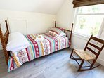 The twin bed is great for that extra person or for reading a book in the afternoon sun!