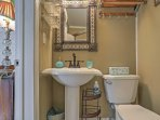 This ensuite bathroom offers added privacy for guests.