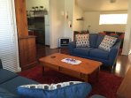 sitting room with gas heater, reserve cycle air conditioning and looking towards kitchen