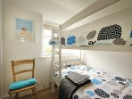 The bunk room, perfect for children with games and books underneath.