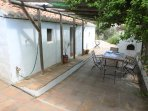 Front of house, patio area for outside meals with original bread oven and BBQ.