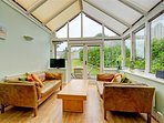 Archway leading from kitchen to comfy sun room and access to rear enclosed garden.