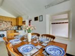 Open-plan kitchen/diner with table and chairs