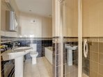 A ground floor family bathroom with bath, shower cubicle, toilet and whb. Towels provided