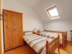 Twin bedded room with bed linen provided.