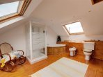 A family bathroom with corner bath, toilet, whb, bidet & shower cubicle.