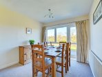 Dining area with patio doors to rear garden.