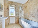 Family bathroom with bath, shower over, WC & WHB.
