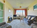 Comfortable lounge with views across Saundersfoot bay