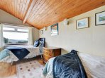 Twin bedded room with window over looking the Saundersfoot bay