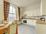 A well equipped kitchen with dining table and chairs again with superb views.