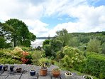 Sea View has a terraced garden leading down to the beach and pub!