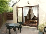 Very useful, enclosed patio with furniture.