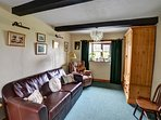 The small second sitting room doubles as a bedroom, with bed settee and large pine wardrobe