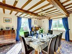 A lovely, spacious beamed dining room for dining in style