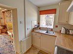 The kitchen is quite compact but well-fitted and maintained