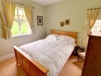 Two windows provide lots of natural light in the ground floor double bedroom - but don't worry, it is very dark at...