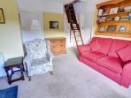 The loft ladder extends down into the sitting room in front of the double bedroom and shower room