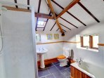 The spacious bathroom, adjacent to the master bedroom (en suite and separate access doors) has a bath and separate...