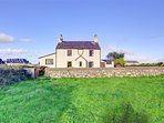 There are open fields to the front of this attractive detached farmhouse