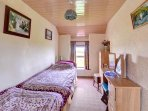 The twin bedroom has end to end single beds, and contmeporary light oak furniture