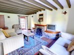This comfortable sitting room has several original features - beamed ceiling, quarry tiled floor and an open fire in...