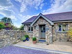 This semi-detached stone cottage on a slate chipped courtyard sits adjacent to the owners' home on the edge of the...