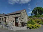 Carnedd Llewelyn is a stone cottage, mostly single storey and wheelchair accessible