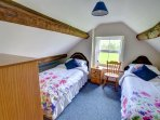 The twin bedroom has a beamed ceiling, and lovely views over the fields