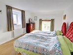 There is a brightly presented twin bedroom