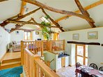 The accommodation, although divided into different areas, has an open plan feel, and is light and airy, with...