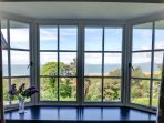 The living room has a gorgeous view over the sea to the Lleyn Peninsula