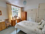 The pretty double bedroom is furnished in pine and is well co-ordinated