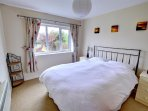 The master bedroom is a good size and furnished with a king size bed
