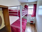 The small bedroom has full sized bunk beds