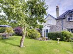 This attractive stone cottage is one wing of the owners' home, a former Vicarage near the river in Newbridge on Wye