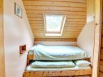 There is a small bedroom for children, with a built-in single bed and pull-out bed below