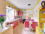 The kitchen diner is bright and cheerful