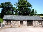 Danycrug Barn is a very pleasant, single storey stone barn conversion on the yard of the owners' working farm