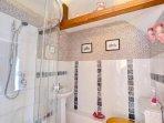 The second bedroom has a smart en suite shower room
