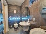 The stylish, contemporary WC has impressive spotlighting!
