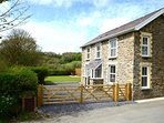 Gwynnant House is an attractive stone cottage in enclosed gardens, on the edge of the village of Rhydlewis
