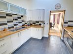 The fitted kitchen includes fridge/freezer, washing machine, tumble dryer and dishwasher