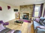 The house has comfortable living room with living-flame stove, books, games, Freeview TV, DVD player