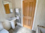 The bathroom has a large heated towel rail, modern furnishings