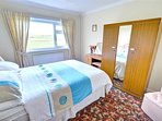 The main bedroom has a double bed and is traditionally furnished